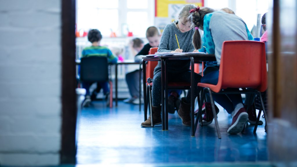 Children working at classroom desks